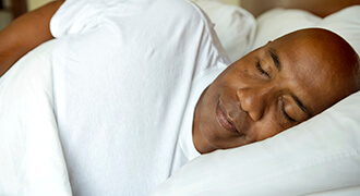 Man with sleep apnea sleeping soundly