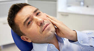 Person experiencing root canal pain