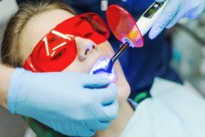 Woman receiving teeth whitening
