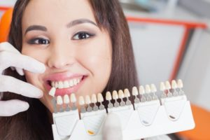 woman smiling beside porcelain veneers
